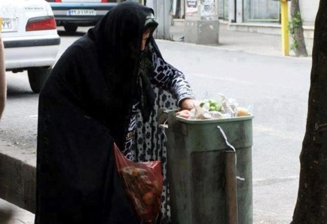 a-poor-woman-in-iran-searches-through-the-trash